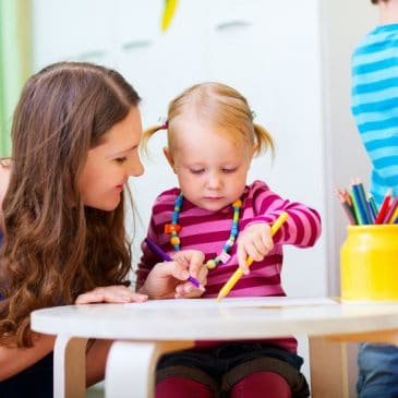 daycare educator with kid