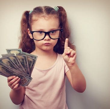 little girl holding money