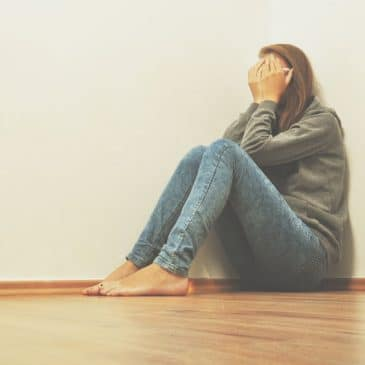 woman sad crying on floor