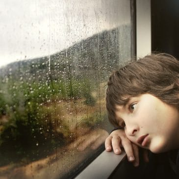 little boy window rain