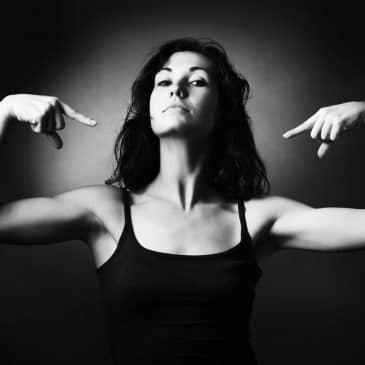 woman pointing herself black and white
