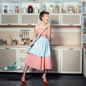 housewife cleaning and singing