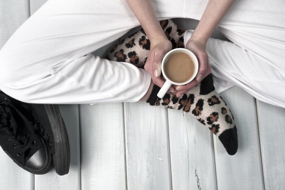 Sweatpants woman with coffee