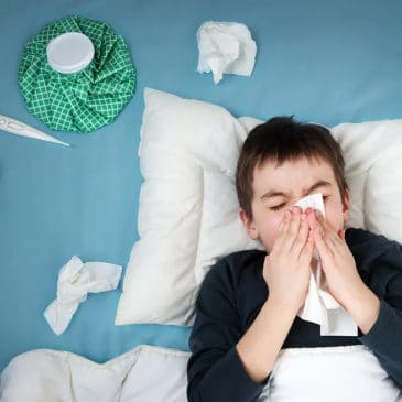 kid sick in his bed