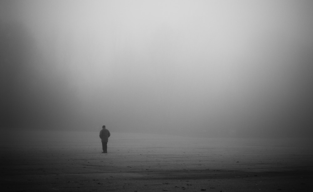 man alone in fog