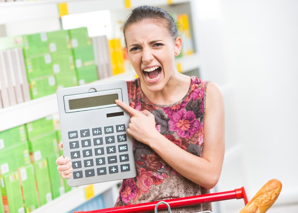 woman angry supermarket calculator