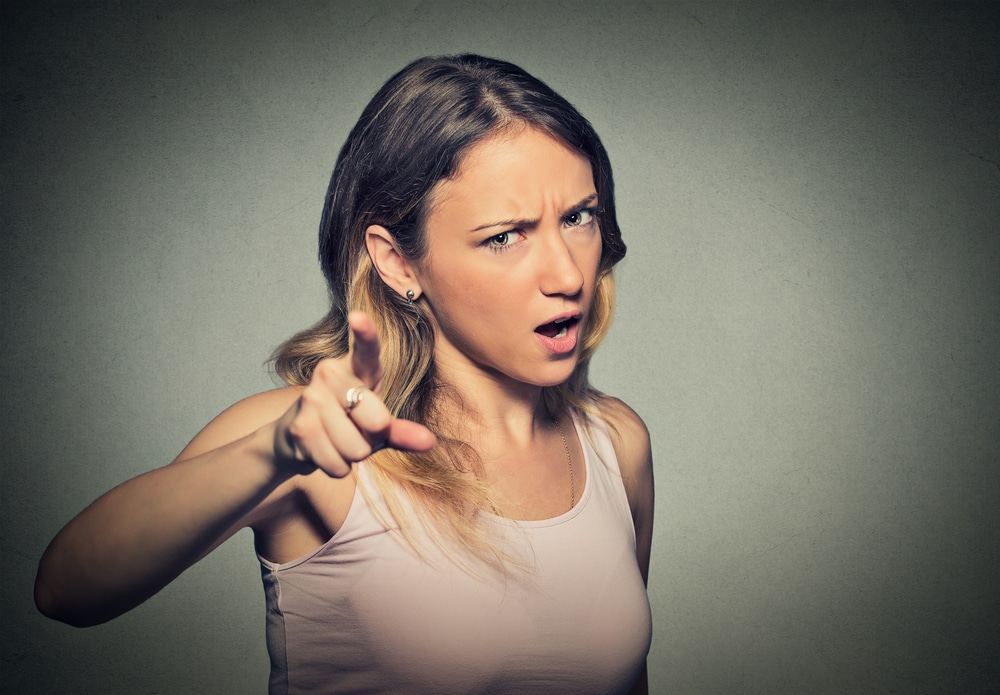 woman furious pointing