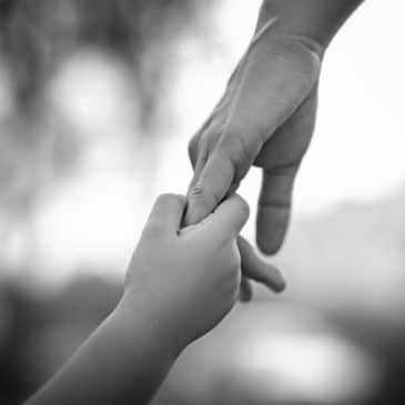 mother daughter hands black and white