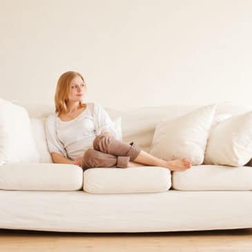 young girl relaxing on couch at home