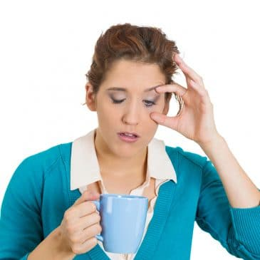 woman tired with coffee