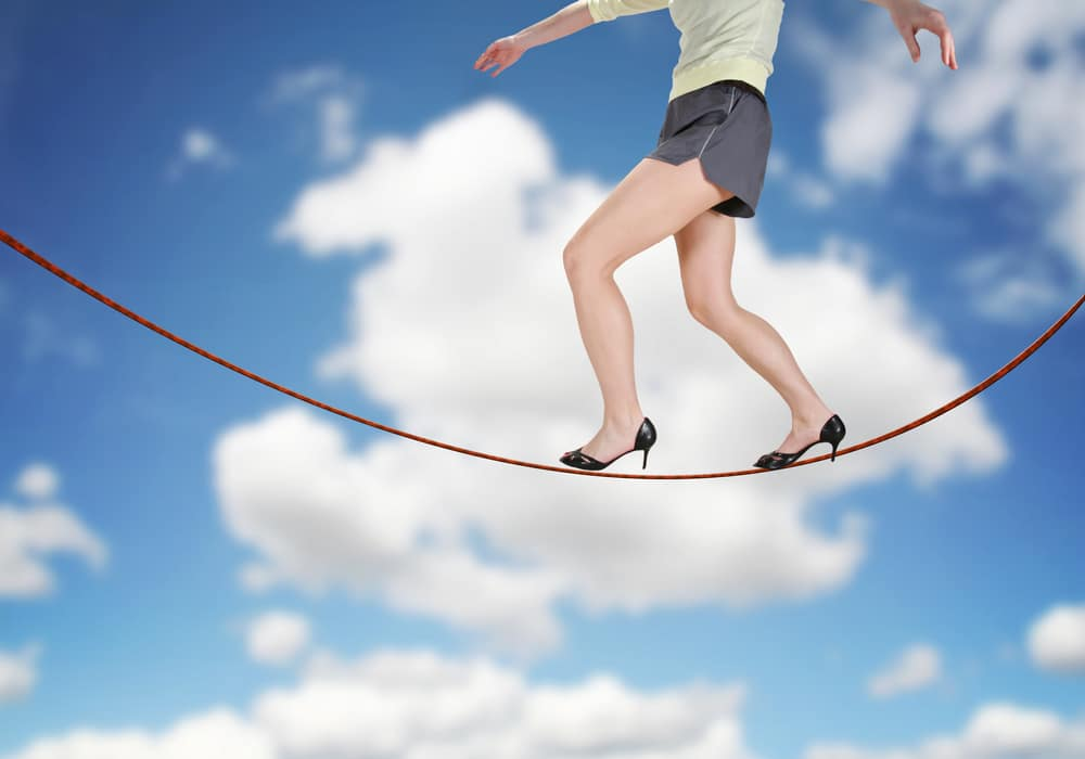 woman on tightrope