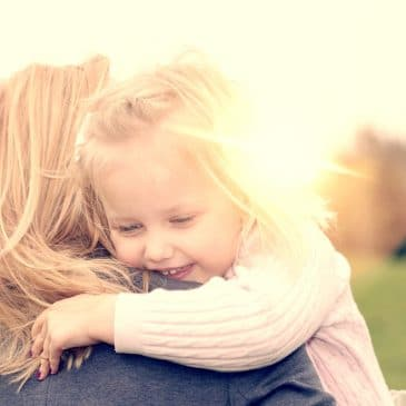 little girl with mother sunny day
