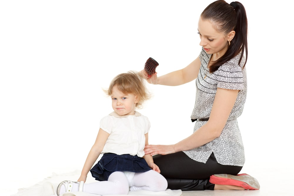 woman with daughter brush hair