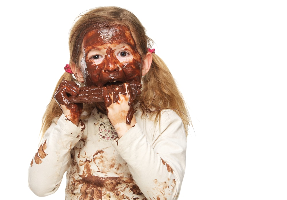 little girl with chocolate