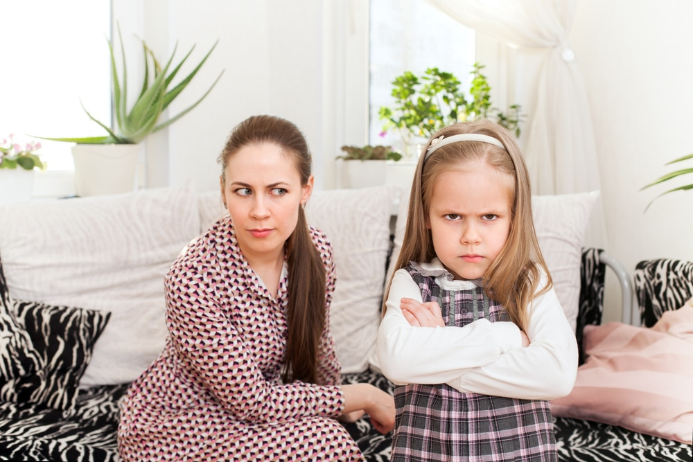 little girl angry with mother