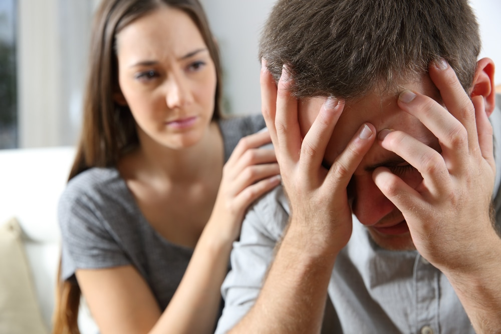 depressed man with girlfriend