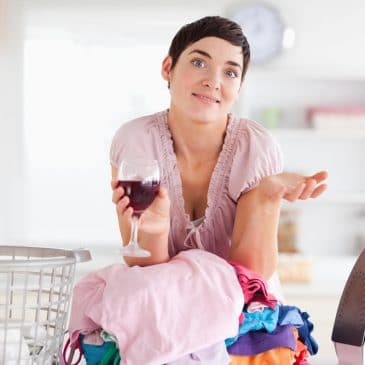 woman drink wine with laundry
