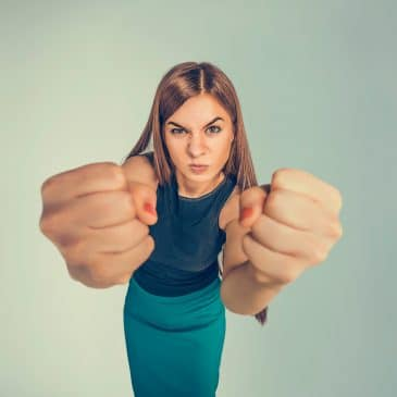 furious woman showing fist