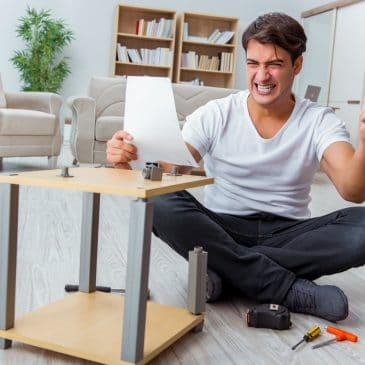 man assemble furniture angry