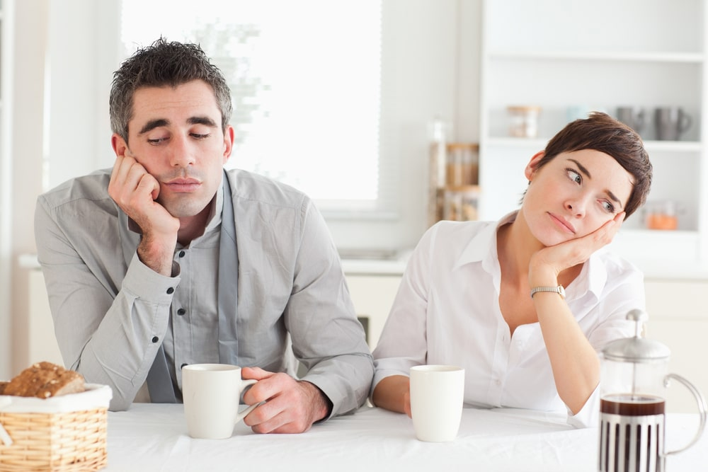 unhappy couple at table