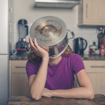 depressed woman in kitchen