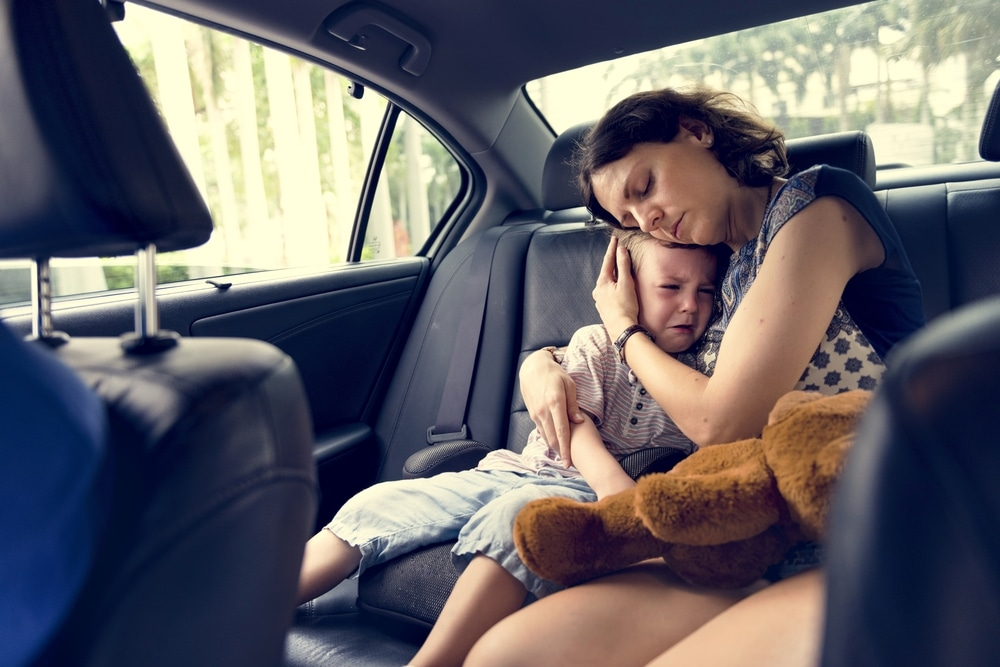 sad mother and son in a car