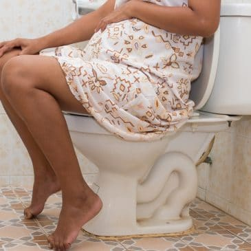 pregnant woman on toilet
