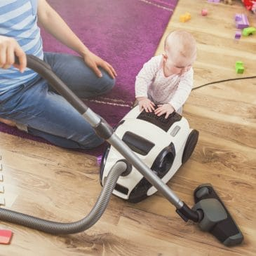 father vacuum with baby