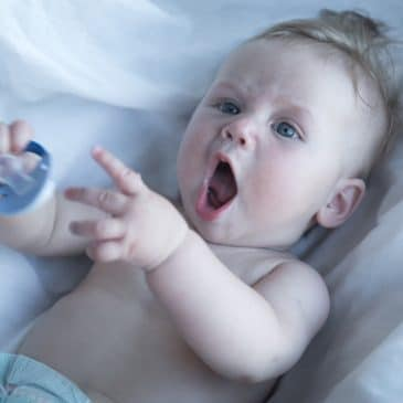 baby funny with pacifier