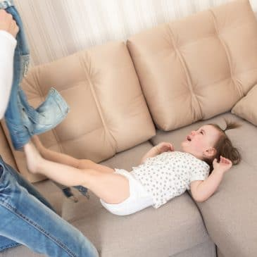 little girl crying on couch