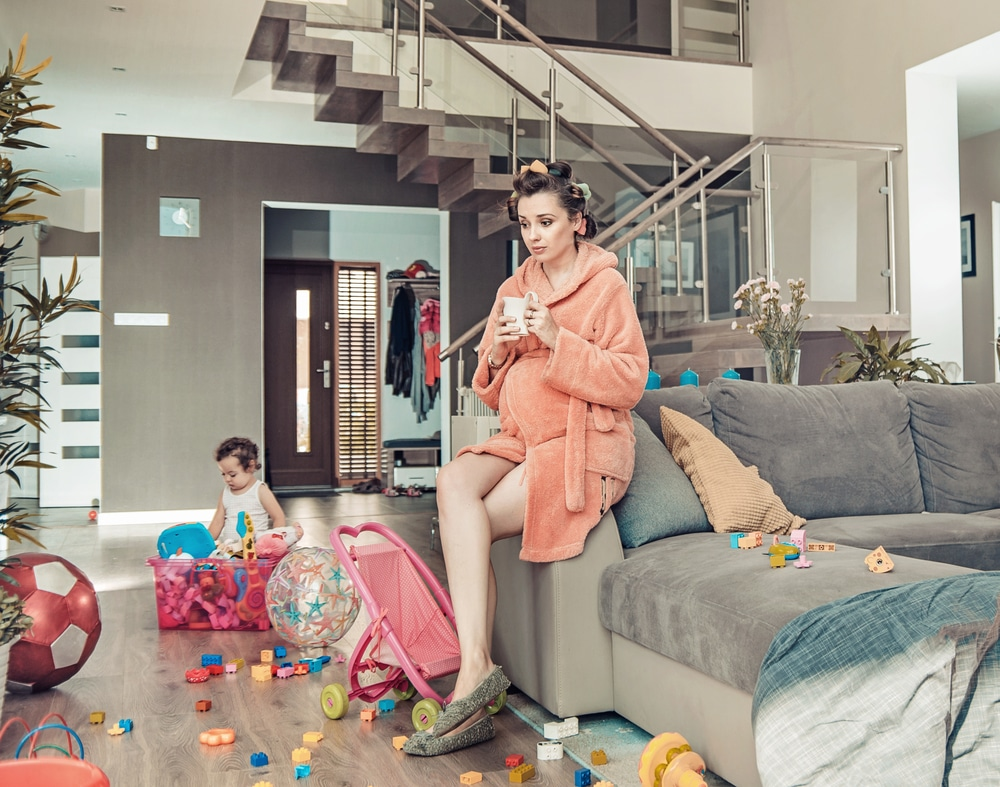 mother with kid in messy living room