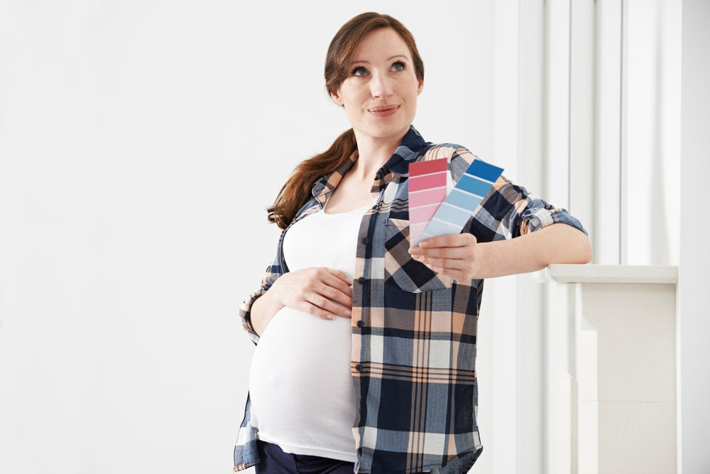 pregnant woman with blue pink paint