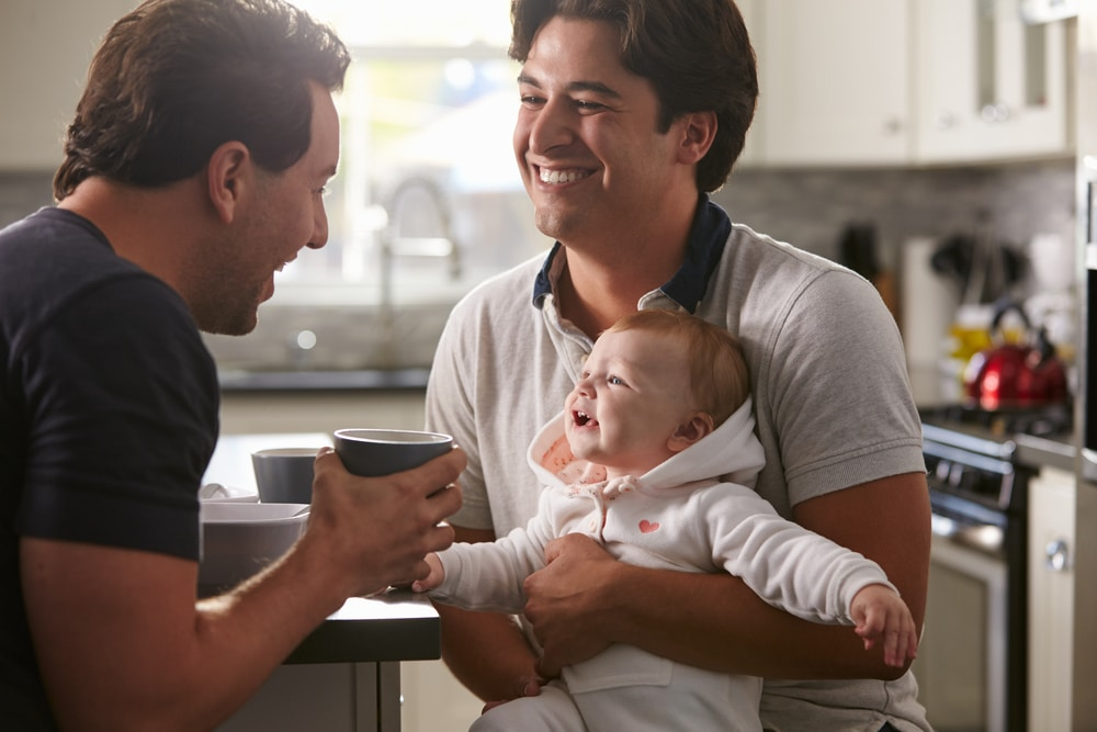two dads with baby