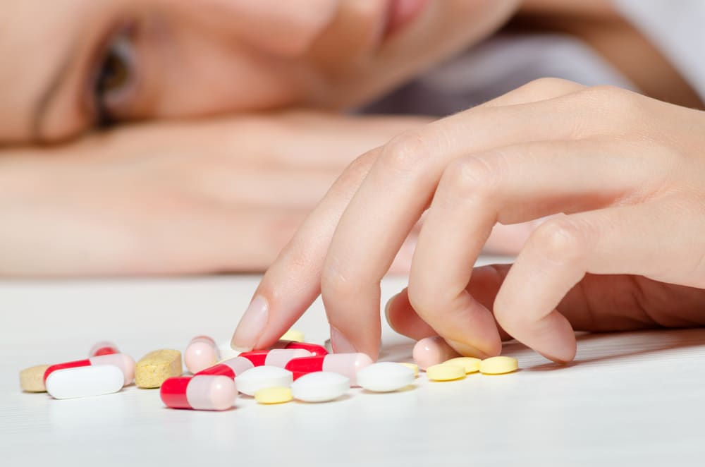 unhappy woman with pills