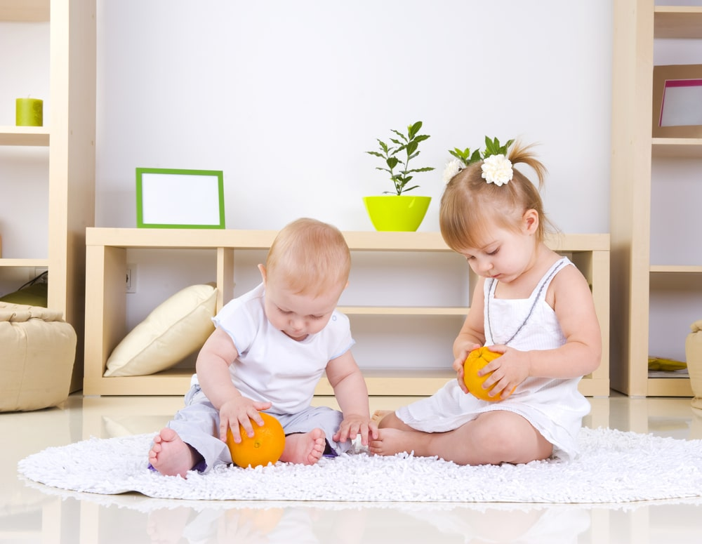 baby and toddler playing