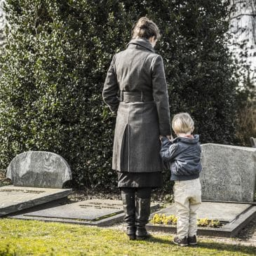 mother and son in cimetery