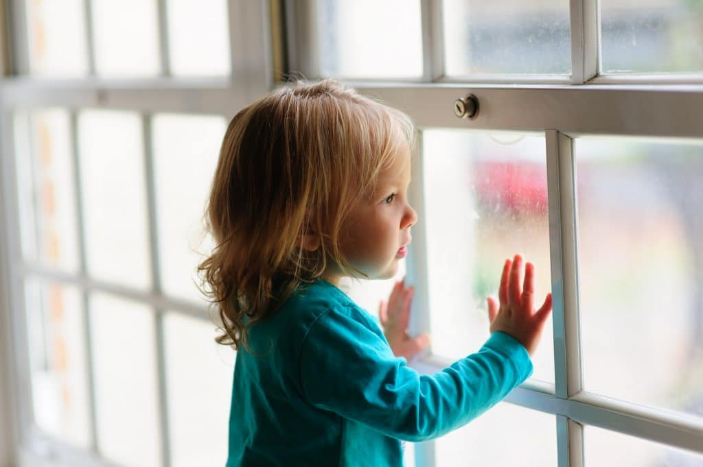 kid on window