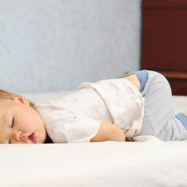 kid sleeping in a funny position