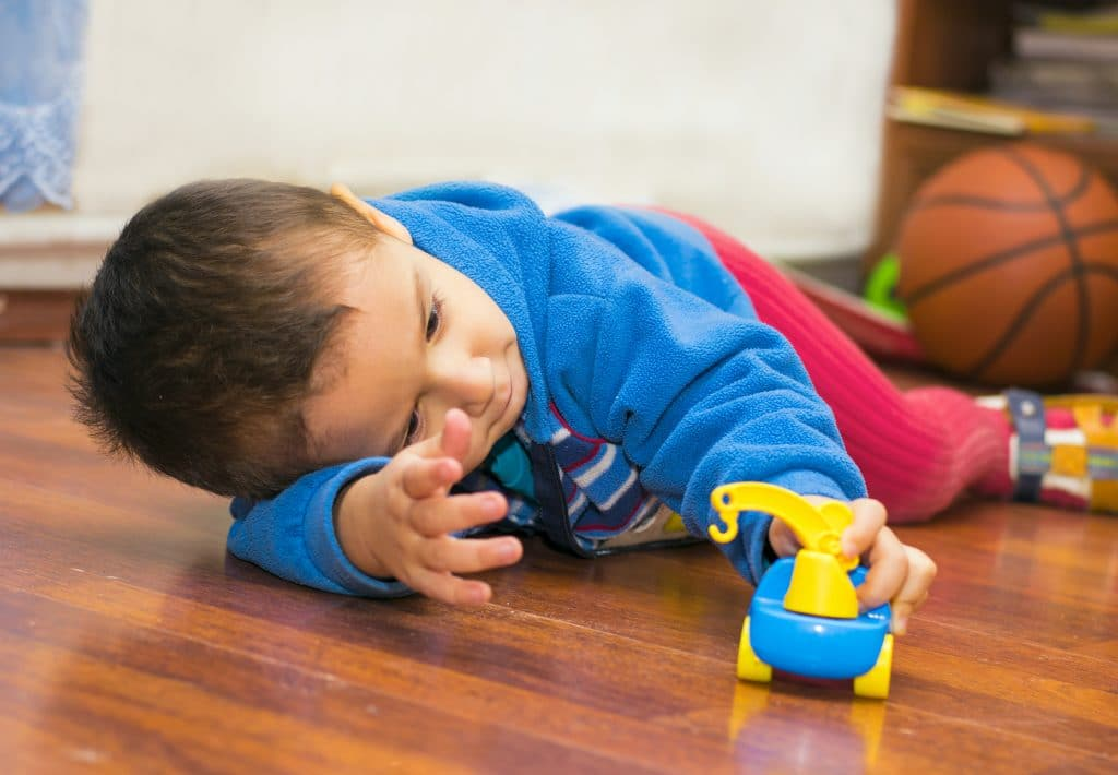 kid playing on the floor