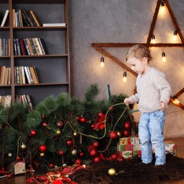 boy with fallen xmas tree