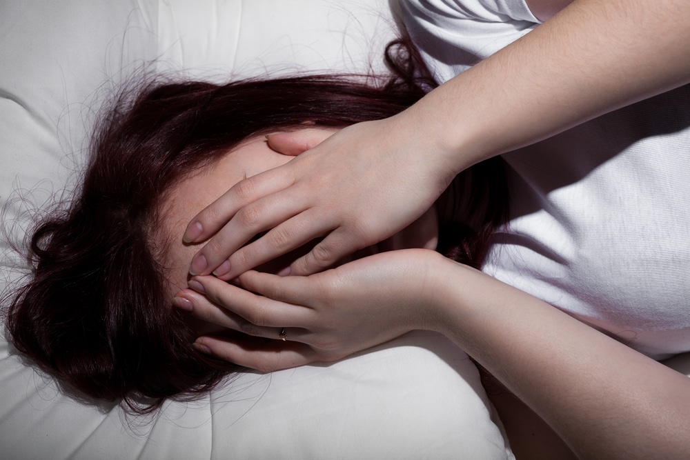 depressed woman in bed