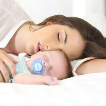 mother sleeping with baby