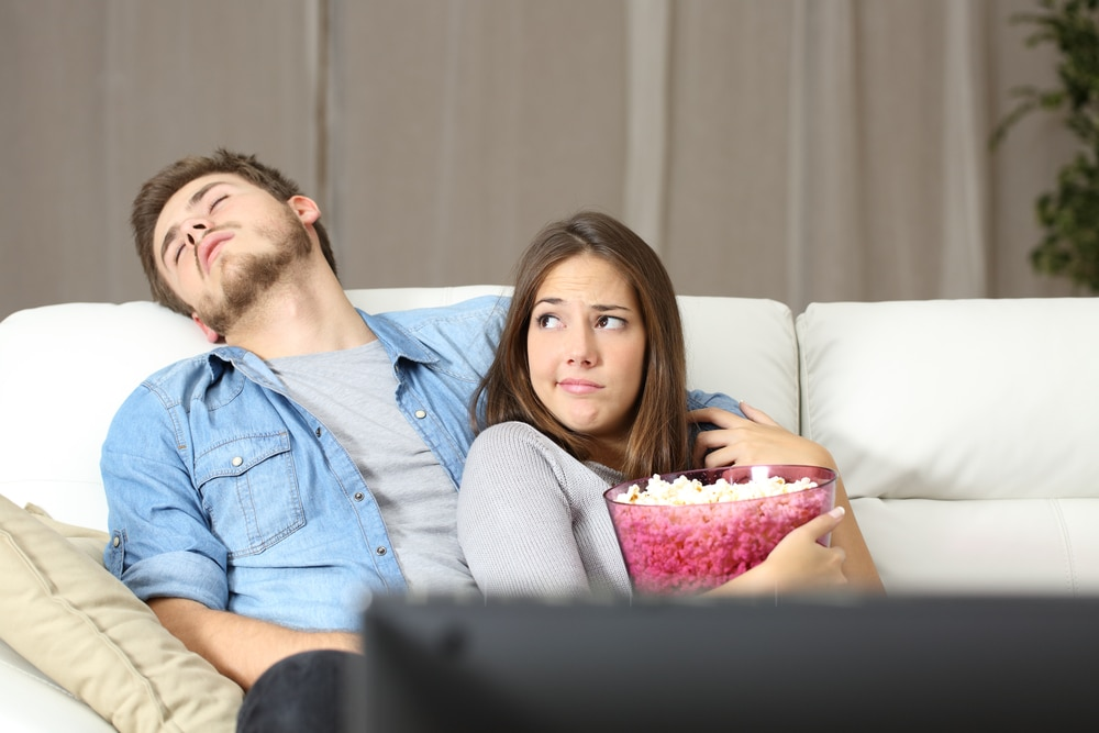 bored couple on couch