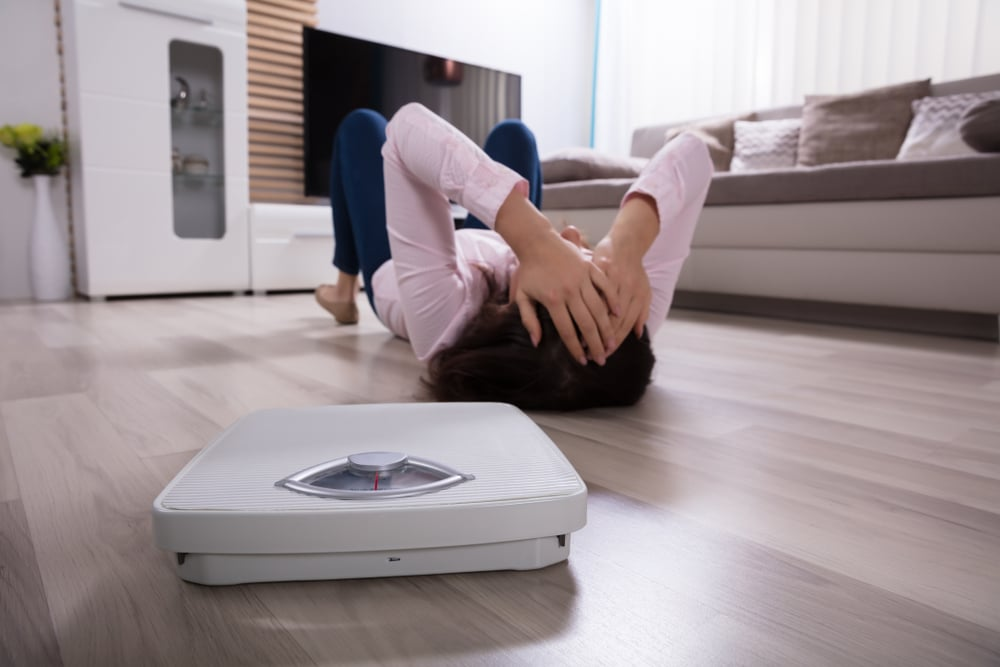 woman on the floor with scale