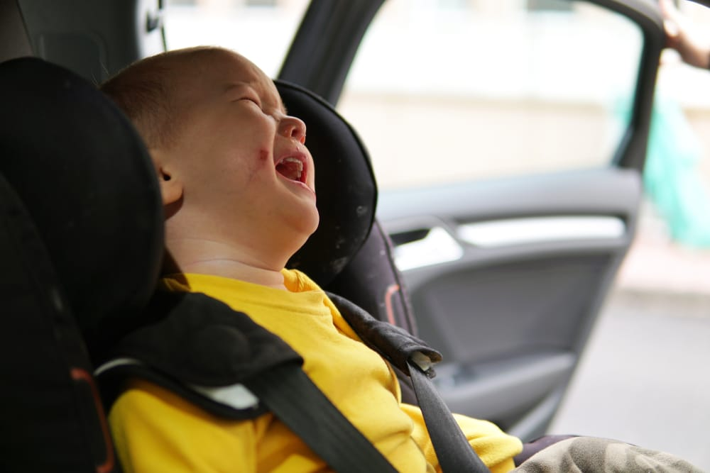 kid crying in car seat