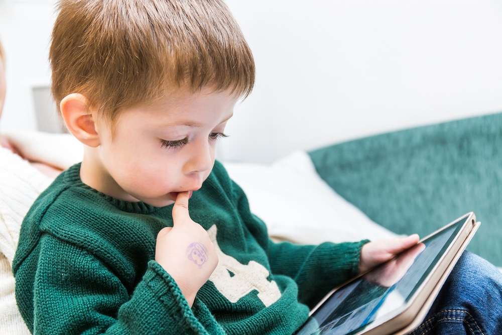 kid with tablet
