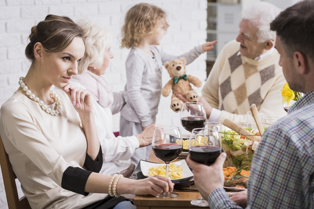 unhappy mother in family dinner