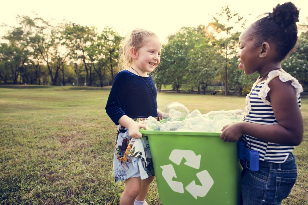 two girls recycle