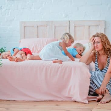tired mother with three kids