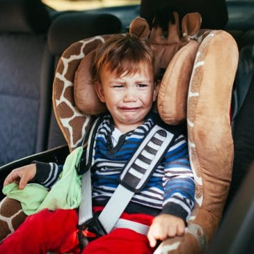 little boy cry in carseat